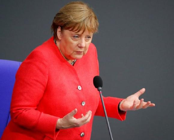 Exasperated Merkel backs widening boardroom quota for women